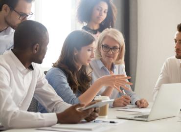 Group of Mentor listens to an entrepreneur