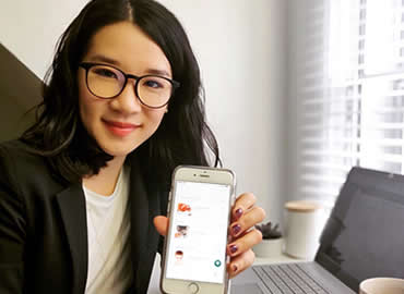 Co-founder Catherine Chan with the Honeybee Hub app.