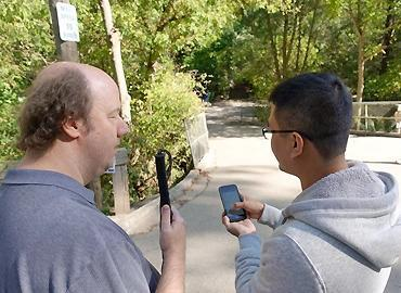 CNIB Foundation's national lead in accessibility and assistive technology Jason Fayre with iMerciv co-founder and CEO Bin Liu testing MapinHood, a pedestrian routing app featuring audible alerts about hazards.